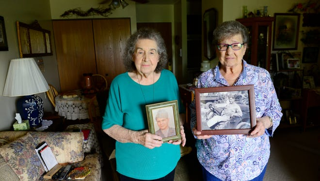 Mary Ocheske, left, and Ethel Smith hold a photo of their brother John Kovach, whose remains are coming back to Port Clinton for burial in July 75 years after he died in World War II.
