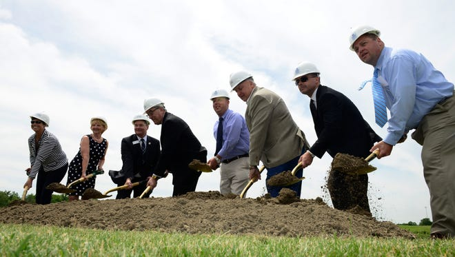 School and local government officials break ground for an on-campus student housing facility at Terra State Community College.