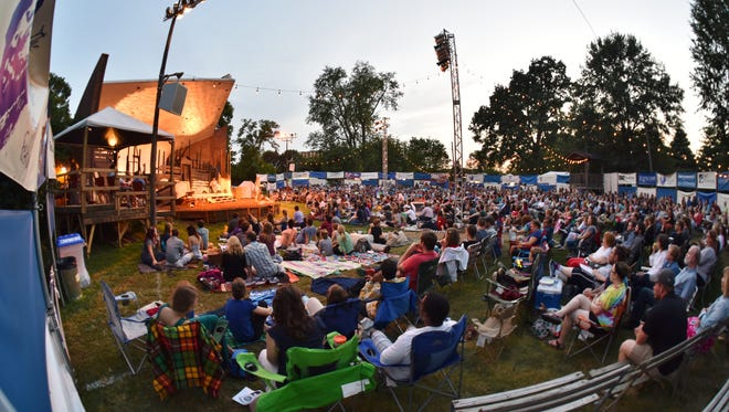 An audience is gathered for Shakespeare in the Park in Nashville's Centennial Park for a past summer performance.