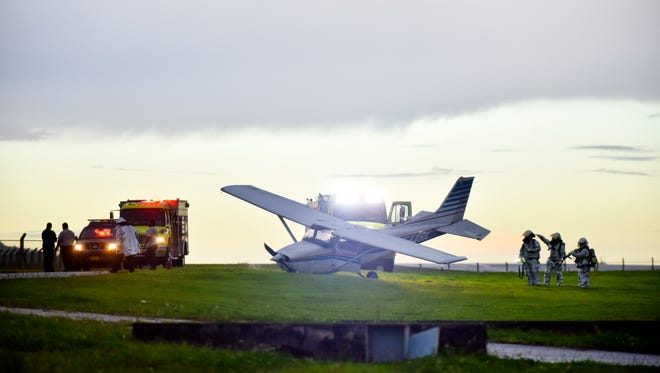 A small plane crash landed at the A.B. Won Pat Guam International Airport Monday afternoon, Sept. 25, 2017. Three people onboard were safe, according to the Guam Fire Department.