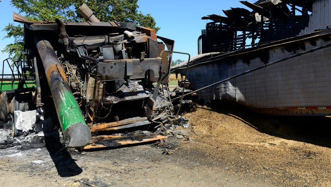 A fire started in a combine and turned the machine into a pile of melted metal.