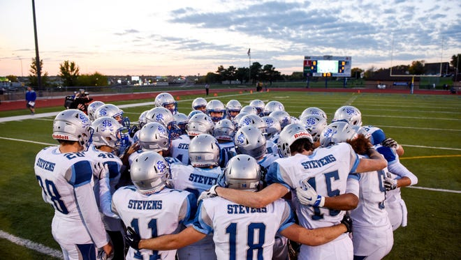 Rapid City Stevens huddle up before the first half of their high school football game on Friday, Oct. 13, 2017 at McEneaneyField in Sioux Falls.