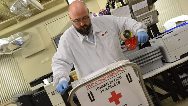 Red Cross employee Bob Otwell prepares blood products including FFP, Whole Blood and Platelets for distribution to nearby hospitals.