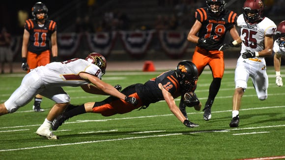 Washington High School Jhett Andersen (12) dives with the ball during a game against Roosevelt High School on Saturday, Sept. 1, 2018 at Howard Wood Field in Sioux Falls, S.D.