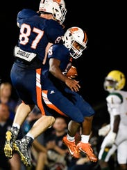 Beech's Kaemon Dunlap (8) celebrates his touchdown