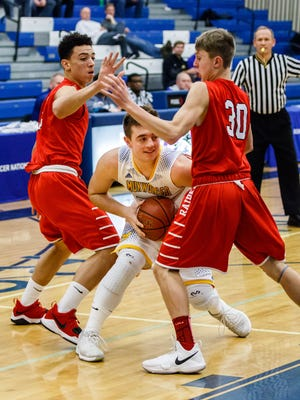 Mukwonago senior Bryce Konitzer (center) gets boxed in during the Luke Homan Memorial Showcase game against Wauwatosa East at Brookfield Central on Saturday, Jan. 20, 2018.