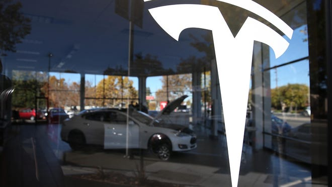 A Tesla showroom in Palo Alto, California. The legal action comes after Michigan officially denied Tesla a new dealership license last week.