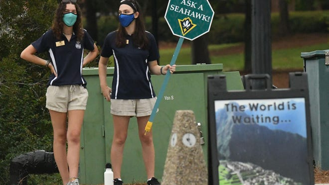 Students, faculty and staff members make their way across the UNCW campus Wednesday, Aug. 19, 2020, in Wilmington, N.C. As thousands of students return to school amid the COVID-19 outbreak, the impact likely will go beyond campus and into the larger Wilmington community.