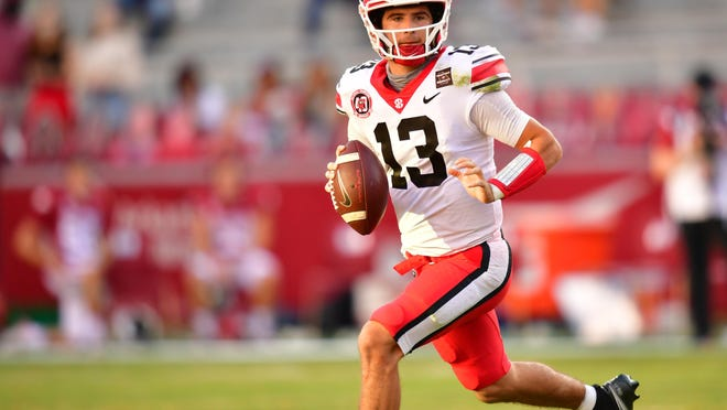 Georgia quarterback Stetson Bennett (13) during the Bulldogs' game with Arkansas in Fayetteville, Ark., on Saturday, Sept. 26, 2020.