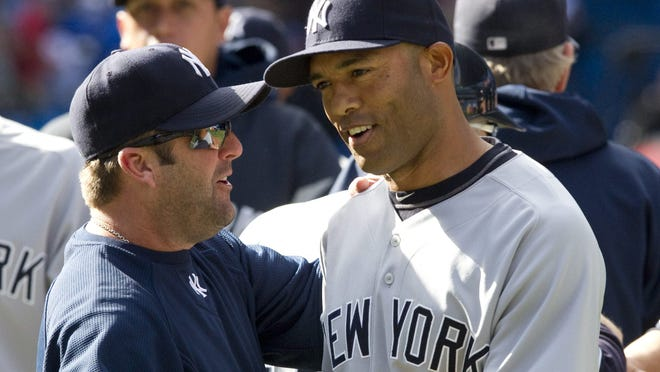 Kevin Long, here with former Yankees closer Mariano Rivera (right), was fired by the Yankees on Friday.