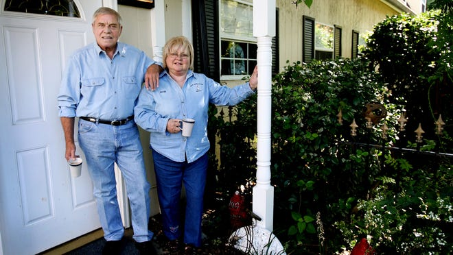 The legendary country songwriter Tom T. Hall and his wife, Dixie, stand outside the studio at their home in Franklin, Tenn. Sept. 29, 2007.