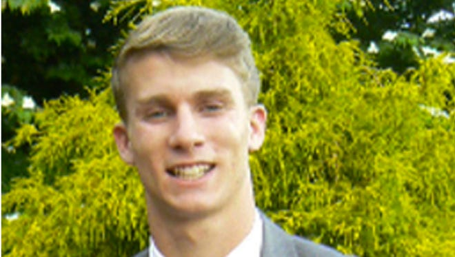 This undated photo released by the Bermuda Police Service shows American college student Mark Dombroski, who has been reported missing in Bermuda. Bermuda police Dombroski was on a rugby tour with Saint Joseph's University, a college near Philadelphia, when he disappeared early March 18, 2018.