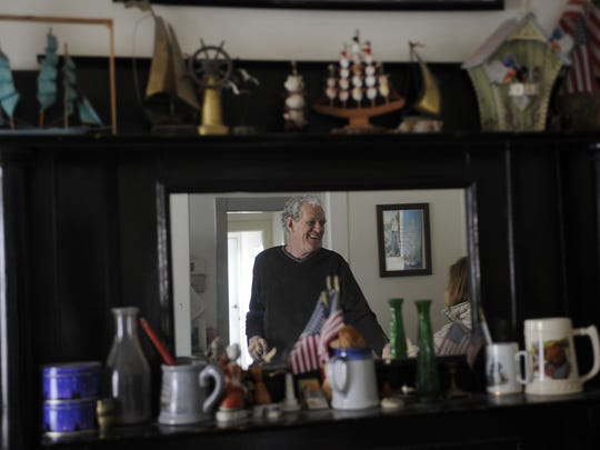 Bobby Yowell is reflected in the mirror in the apartment in his living room. Bobby Yowell and Gary Kiracofe grew up in institutions for mentally disabled people, but now live together in an apartment in Staunton. Photos taken with the men on Thursday, January 20 2011.