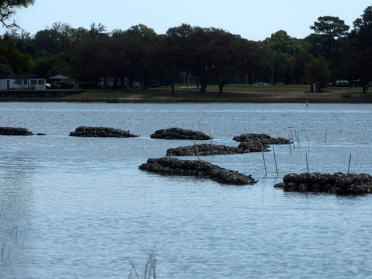 Some Navy Point residents question Escambia County's placement of artificial reefs in Bayou Grande, Friday, April 6, 2018. Some the residents in the neighborhood are concerned the new additions to bayou are health hazards.
