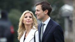Jared Kushner, right, White House senior adviser, walks
