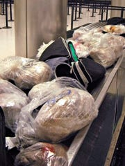 """This undated photo released by the U.S. Customs and Border Protection (CBP) shows seized 450 prohibited pork meat tamales discovered inside the luggage of a passenger arriving at the Los Angeles International Airport (LAX) from Mexico, on Nov. 2, 2015, in Los Angeles. """"Although tamales are a popular holiday tradition, foreign meat products can carry serious animal diseases from countries affected by outbreaks of Avian Influenza, Mad Cow and Swine Fever said Anne Maricich, CBP Acting Director of Field Operations in Los Angeles. (U.S. Customs and Border Protection via AP)"""