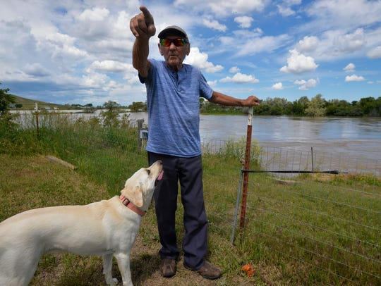 Richard Matsko, who lives on Sun River Road, talks
