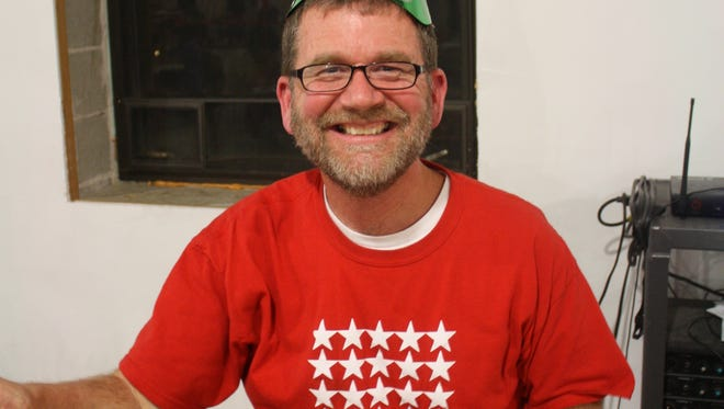 Green Lake Renewal Board Member and Bingo Caller Phil Burkhart shows his excitement for New Year's Eve Bingo.
