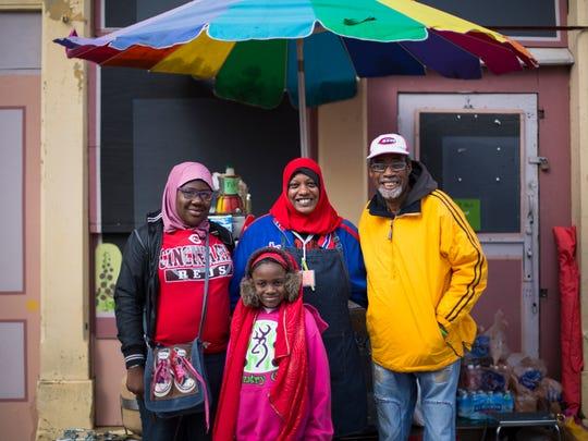 (From left:) Khadijah Diop, sister Aisha Diop, mother