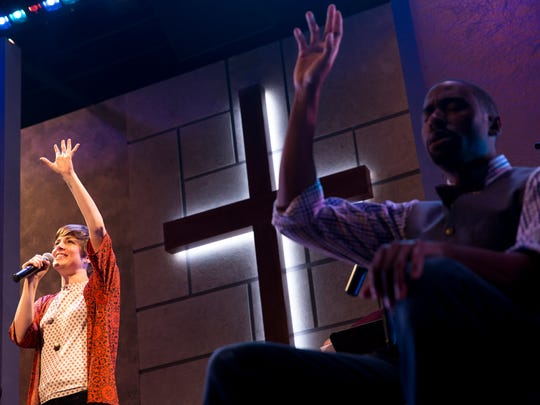Worship leader Jenny, played by Kate Fahrner, and Associate Pastor Joshua, played by William Oliver Watkins, sing during dress rehearsal for Gulfshore Playhouse's production, The Christians, Tuesday, April 25, 2017 in Naples. The production opens this Saturday at the Norris Community Center. The intimate play asks questions about faith and its power to unite or divide us.