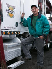 Tim Capuano of Penfield has been driving for R H Harding Trucking Co. for 20 years.