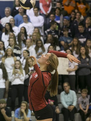 Mount Olive junior Annie Karle goes up for a kill during the Morris County Tournament final.