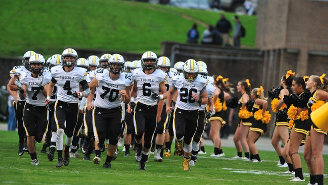 Tuscola football players take the field for a game earlier this season at McDowell. The Mountaineers are 4-0 after Friday's home win over Swain County.