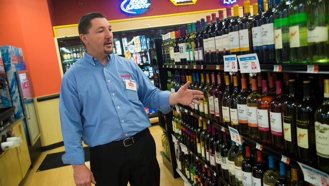 Store manager John Miller talks about the varieties of wine available to customers at Weis Markets on Baltimore Street in Hanover on Dec. 1, 2016.