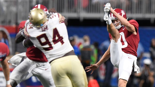 Alabama punter JK Scott (10) punts in the Chick-fil-a Classic at the Mercedes - Benz Stadium in Atlanta, Ga., on Saturday September 2, 2017. (Mickey Welsh / Montgomery Advertiser)