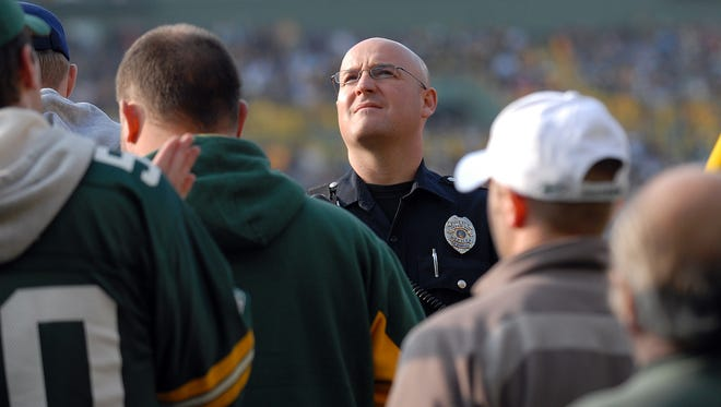 Police arrested 14 people and ejected 37 at Sunday night's Green Bay Packers-Seattle Seahawks game at Lambeau Field.