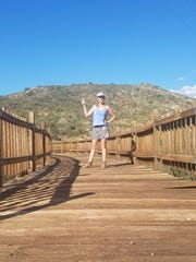 Anna Dozier stops for a moment while crossing a bridge