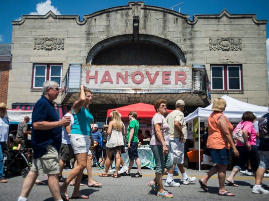 People walk down Frederick Street during a festival in downtown Hanover.