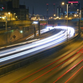 Traffic is moving along I-43 in Milwaukee in the 4 second exposure in February. A study released Thursday says that Milwaukee-area commuters are spending an additional $2,060 annually because of delays from congestion and traffic accidents.