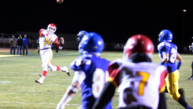 Palm Desert quarterback throws a touchdown pass to Tristan Sinkinson in the third quarter against Serrano on Friday during the CIF Eastern Division semifinals played in Phelan, CA.