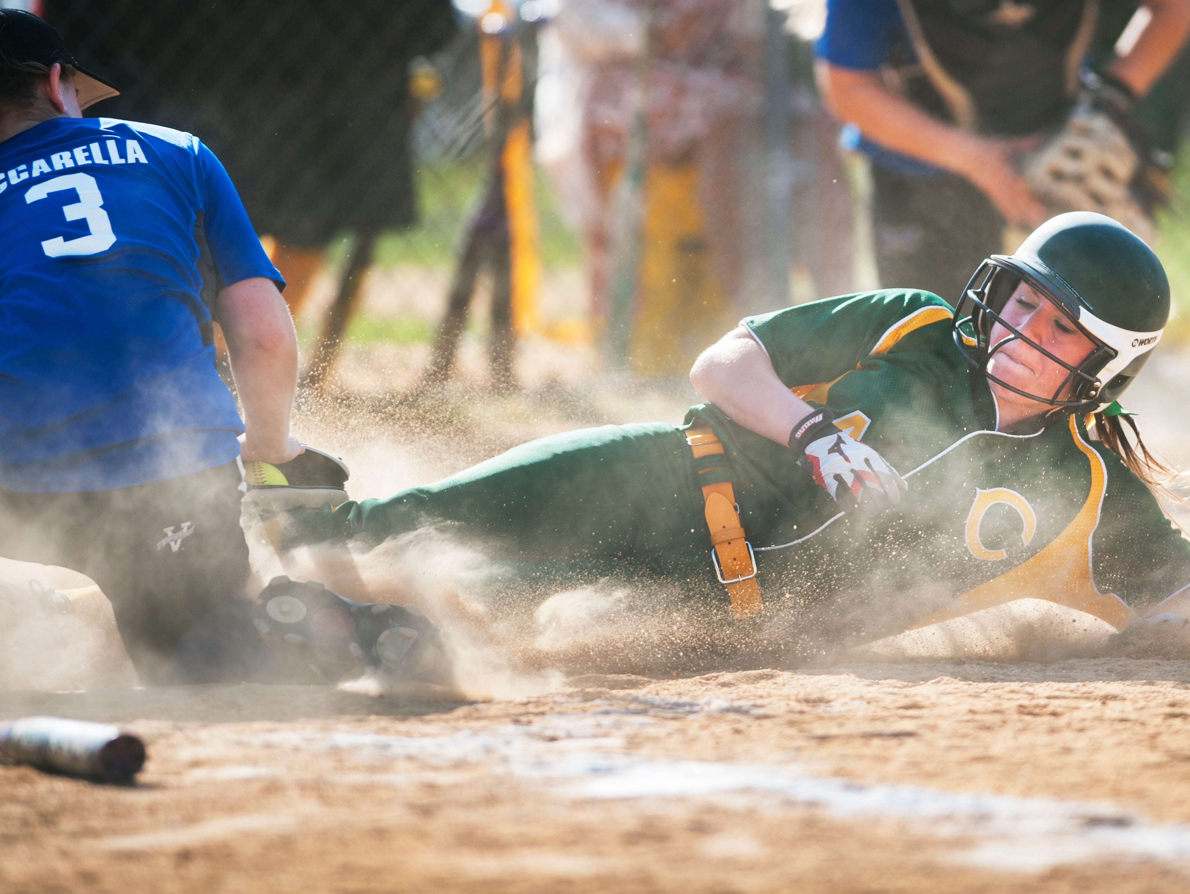 Clearview's Miranda Turner, right, scores the game winning run as Hammonton's Nicole Vaccarella covers the plate, after a throwing error in the bottom of the 6th inning of Wednesdays softball game played at Clearview High School. 04.29.15