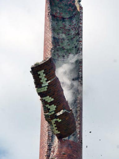 Billy Foust's smokestack is brought most of the way