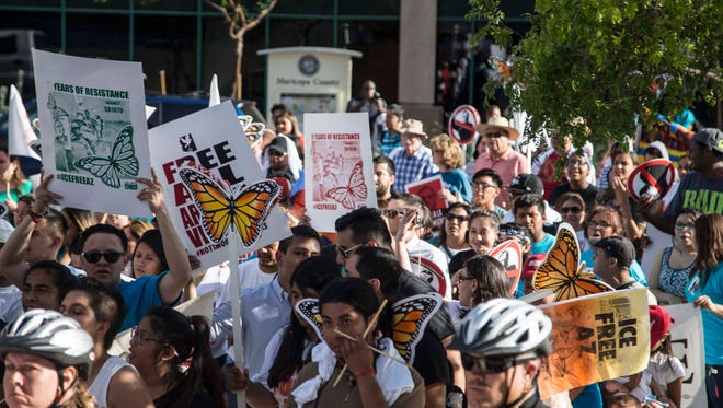 Hundreds of demonstrators walk from Arizona State Capitol to Federal Court house to mark the fifth anniversary of SB1070 on April 23, 2015 in Phoenix. Four of the demonstrators were arrested after blocking the road near Federal Court.