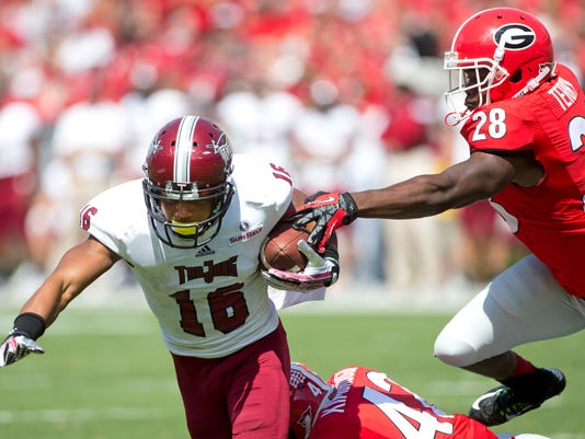 Troy wide receiver Chandler Worthy (16) is brought down by Georgia's Tim Kimbrough (42) and Kyle Vagher (28) as he returns a kick in the first half of an NCAA college football game, Saturday, Sept. 20, 2014, in Athens, Ga. (AP Photo/John Bazemore)