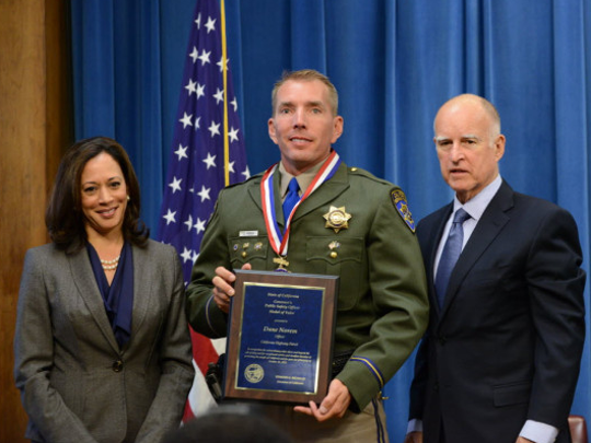 Dane Norem recieves a California Medal of Valor Award from then-Attorney General Kamala Harris and Governor Jerry Brown