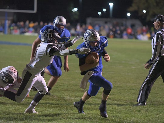 Zach Hoffman sheds a tackle against Gibsonburg in the