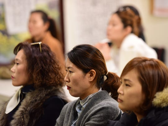 Members of North Jersey's Korean community listen at