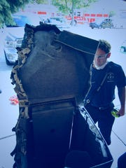 Firefighters had to cut the top off the gun safe to rescue the boys.