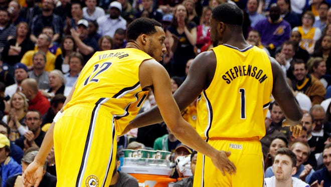 Indiana Pacers guard Evan Turner, left, congratulates guard Lance Stephenson after he was fouled and scored against against the Los Angeles Lakers at Bankers Life Fieldhouse.
