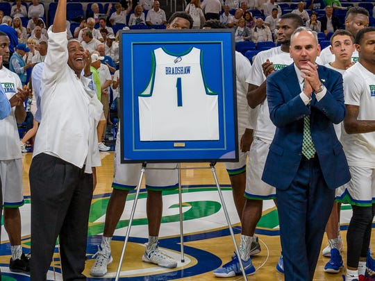FGCU athletic director Ken Kavanagh, right, knows he doesn't have the resources to win a bidding war should a major program come after FGCU fourth-year men's basketball coach Joe Dooley. But he'll do what he can to try and retain him if it comes to that.