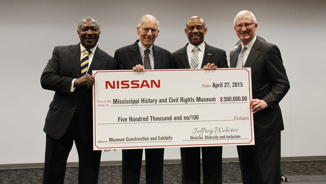 From left, State Sen. John Horhn, D-District 26; former Gov. William Winter; Jeffrey Webster, Nissan director of diversity and inclusion; and former Gov. Ronnie Musgrove hold a check for $500,000 to be used for the Mississippi History and Civil Rights Museum.