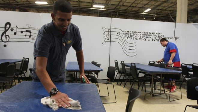 Luis Babilonia, 22, of Asbury Park and Anthony Manrodt, 20, of Middletown clean tables at Center for Vocational Rehabilitation, a center which helps people with disabilities learn job skills, in Eatontown, NJ Tuesday January 5, 2015.