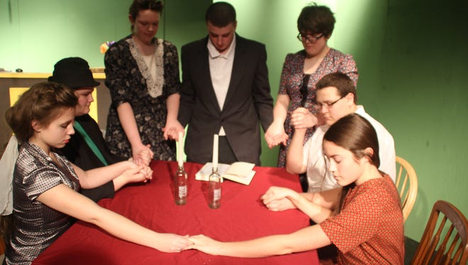 The family that prays together stays together, and it comes to pass in this heartwarming Hanukkah scene. Clockwise from left: Claire Kingland, Nathan Jackson, Kaitlynn Kinzler, Dakota Gesling, Jacquelyn Barney, Austin Galarza and Taylor Gerard.