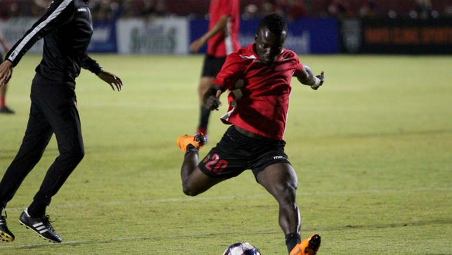 Solomon Asante kicks the ball before the Phoenix Rising's playoff game against the Portland Timbers 2 on Friday night at Phoenix Rising Soccer Complex on Oct. 19.
