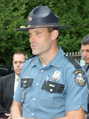 Lt. Aaron Hayden of the Maine State Police holds a