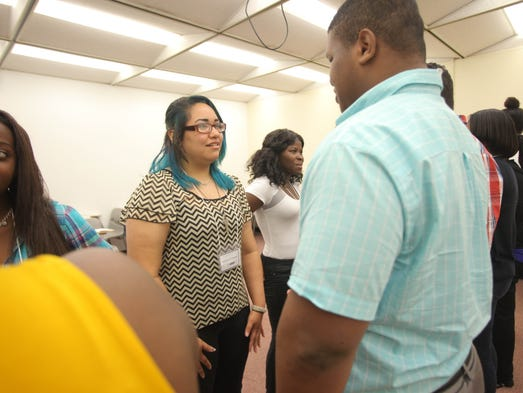 Melissa Wildman, center, goes through job training with Roddmy Remy during Rockland Youth Bureau's TEACH program at Rockland Community College in Ramapo on July 8, 2014.
